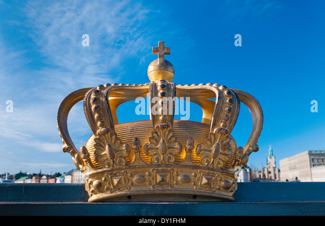 Stockholm Harbour Crown on bridge. Gamla Stan in background. Sweden - Stock Image