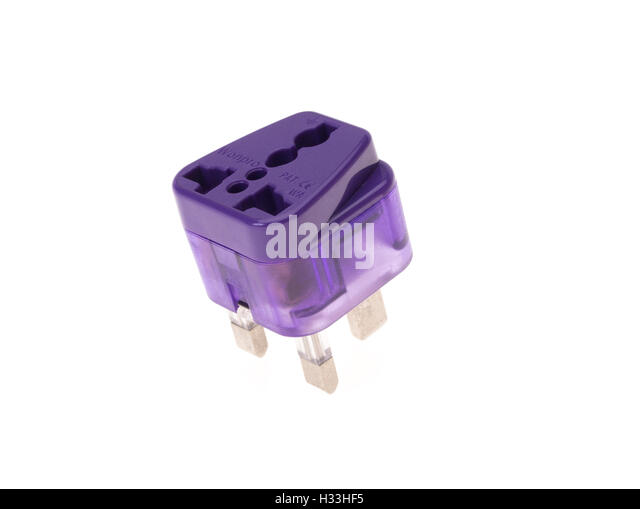 Travel adapter European US to three pin UK - Stock-Bilder