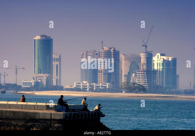 Qatar Doha bay skyline angler - Stock Image
