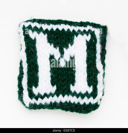 Knitted letter M woollen lettering. - Stock Image
