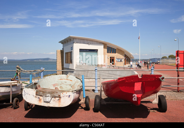 Morecambe, Lancashire, England, UK, Britain. Boats and RNLI Lifeboat station on the seafront in the bay - Stock Image