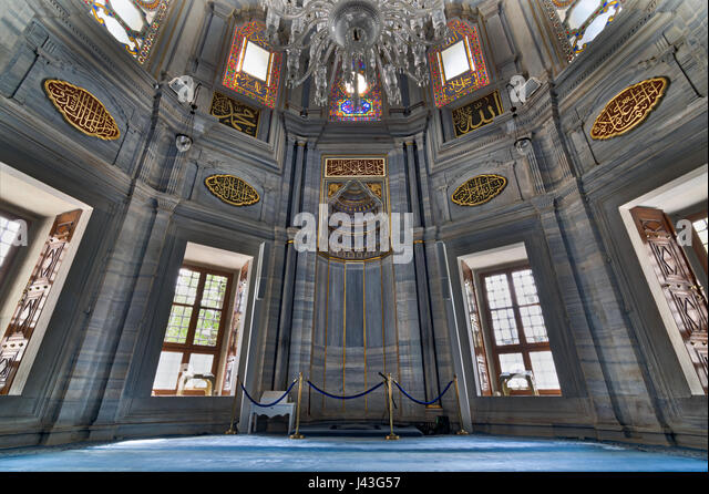 Interior of Nuruosmaniye Mosque showing the Niche (Mihrab), marble wall and stained glass windows, an Ottoman Baroque - Stock Image