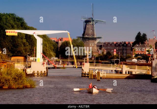 Amsterdam draw bridge and windmill - Stock Image