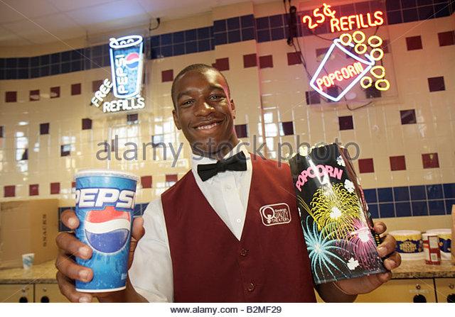 Indiana Portage Portage 16 IMAX movie theater complex food concession soda Pepsi popcorn snack Black man neon signs - Stock Image