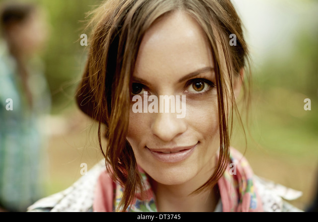 A young woman with long brown hair smiling - Stock Image