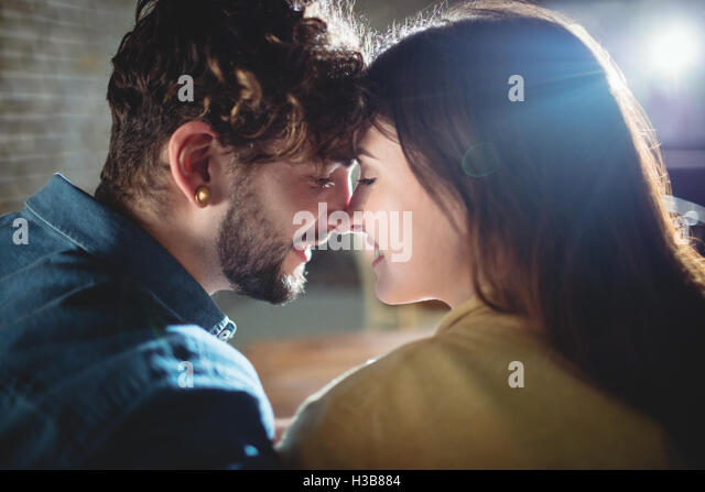 Close-up of romantic couple at cafe - Stock Image