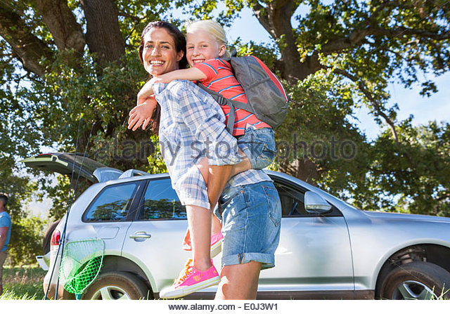 Mother And Daughter Enjoying Walk In Countryside Trip - Stock Image