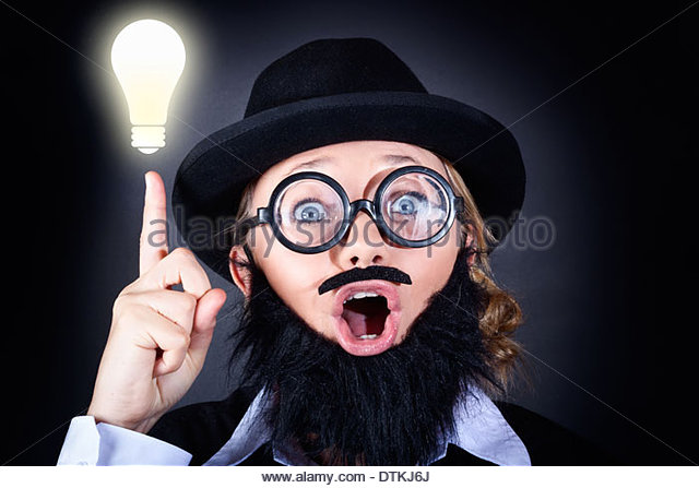 Crazy male scientist wearing nerd glasses, fake moe and plastic beard pointing up to bright lightbulb with expression - Stock Image