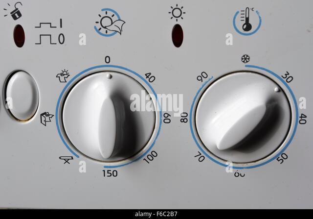 Old washing machine/dryer dials showing 30 degree centigrade wash - Stock Image