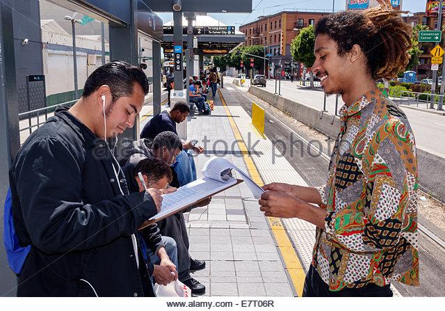 Los Angeles California CA Downtown LA County Metro Rail urban rail system mass transit public transportation Gold - Stock Image