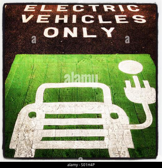 Parking space and recharging point for electric vehicles. - Stock Image