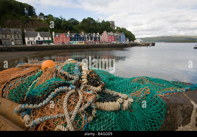 Fishing nets and cottages Tobermory Mull Scotland - Stock-Bilder