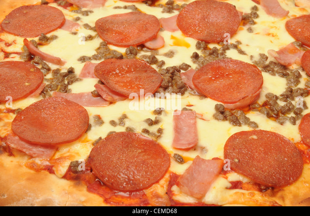 Pepperoni pizza topping - Stock Image