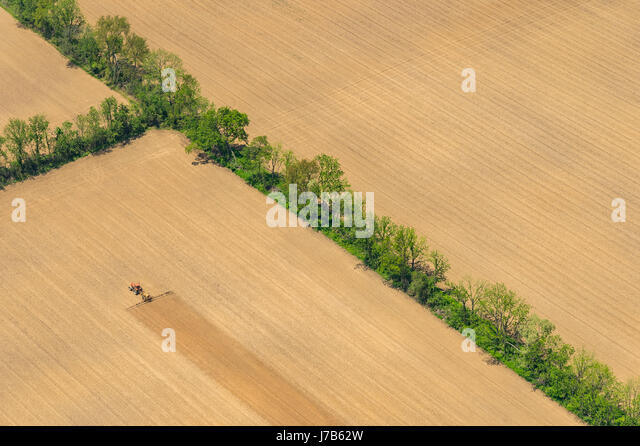 Aerial View Of Tractor Plowing Farm Field - Stock Image