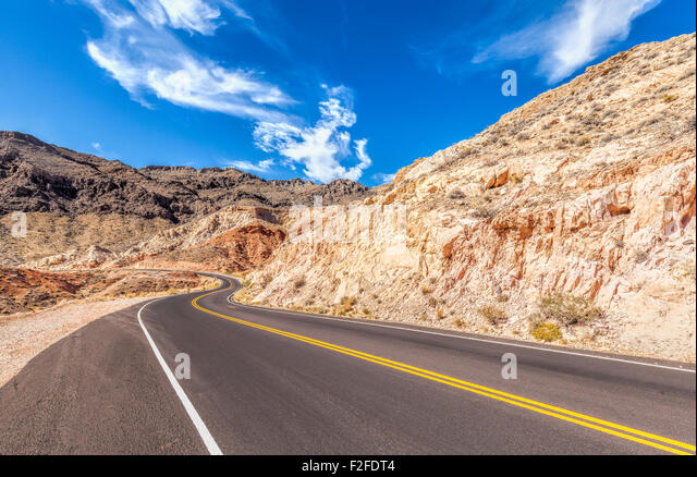 Country curved road in USA, travel concept. - Stock-Bilder