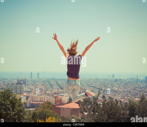 Woman jumping in the air, Barcelona, Spain - Stock Image
