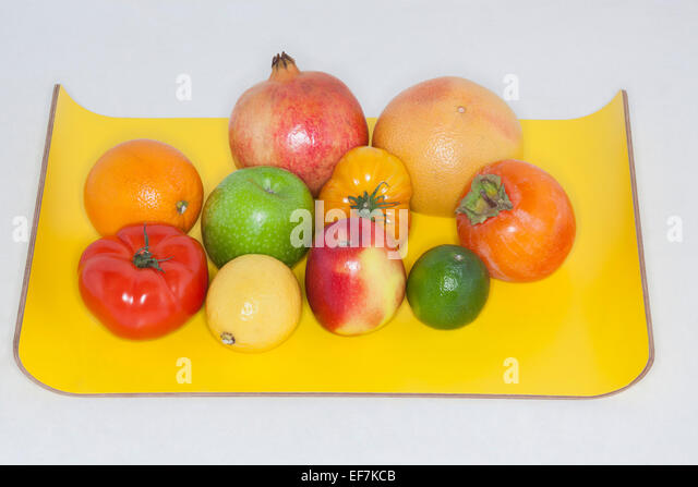 Close-up of assorted fruits on a tray - Stock Image