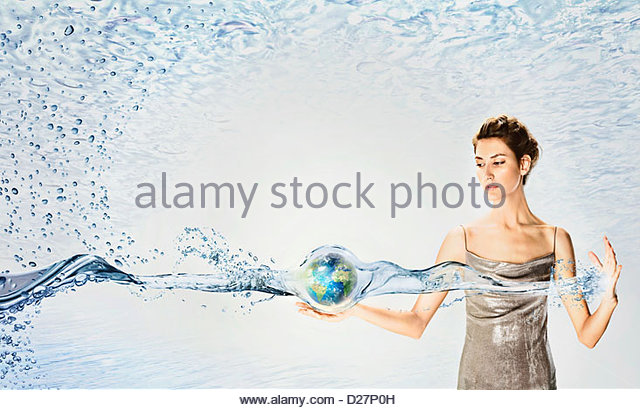 Woman holding globe surrounded by water - Stock Image