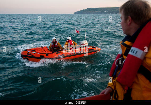RNLI life boat volunteers out on the Solent from Bembridge RNLI station, Isle of Wight. Photo:Jeff Gilbert - Stock Image