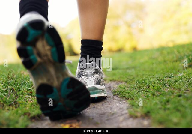 feet-of-a-runner-in-park-woman-walking-i