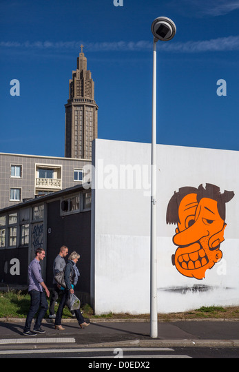 GRAFFITI ON A CITY WALL BOULEVARD CLEMENCEAU AND THE TOWER OF THE SAINT-JOSEPH CHURCH LE HAVRE SEINE-MARITIME (76) - Stock Image