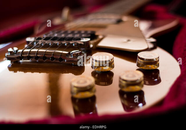 Closeup of tone knobs and volume of an electric guitar. - Stock Image