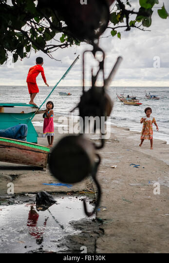 Children playing at fishermen village in Bengkulu, Sumatra, Indonesia. - Stock Image