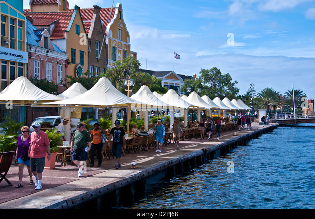 Punda Willemstad waterfront Curacao wth outdoor dining and colorful Dutch architecture - Stock Image
