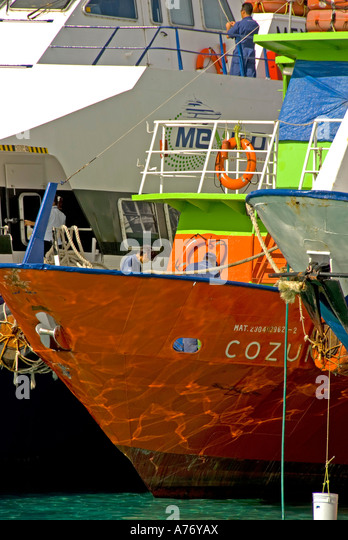 Cozumel Mexico San Miguel town brightly colored ferry boats at harbor dock - Stock Image
