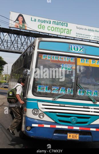 Nicaragua Managua Pista Juan Pablo II street scene traffic bus public transportation passenger boarding - Stock Image