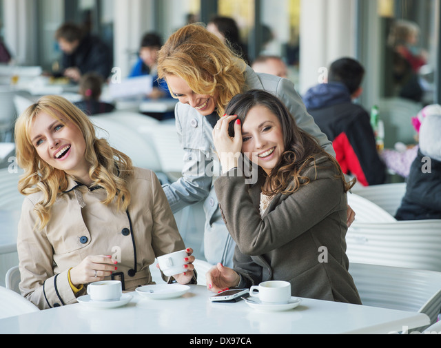 Group of laughing young ladies - Stock Image