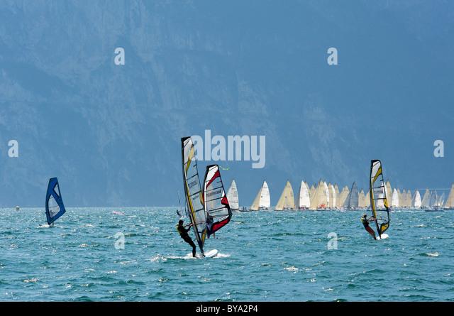 Wind surfers on Lake Garda near Torbole, province of Trento, Trentino, Italy, Europe - Stock Image