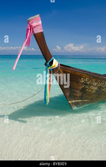 Thailand, Andaman Sea, Phuket, Bamboo Island. Traditional Thai longtail boat. - Stock Image