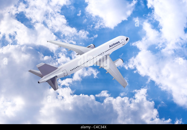 commercial plane model over cloudy sky background - Stock Image