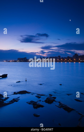 Uruguay, Montevideo, view from La Rambla, waterfront, dusk - Stock Image