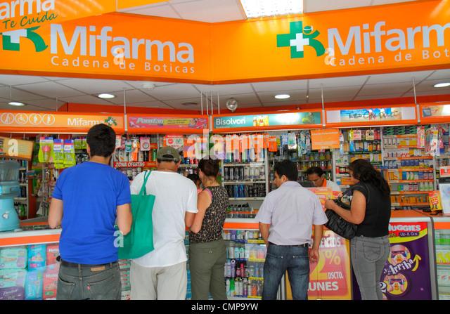 Lima Peru Jiron de la Union Mifarma business chan pharmacy drug store medication healthcare counter Hispanic woman - Stock Image