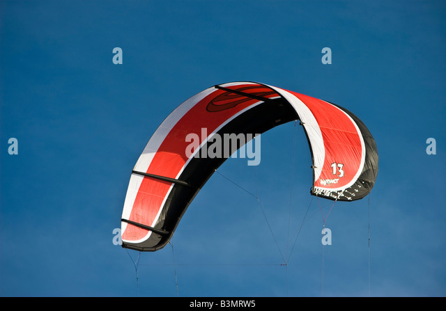 Kites fly on the beach at St Peter Ording Schleswig Holstein North Germany - Stock Image