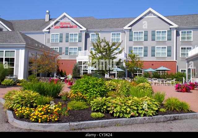 Maine Freeport Hilton Garden Inn motel hotel front outside entrance landscape flowers - Stock Image