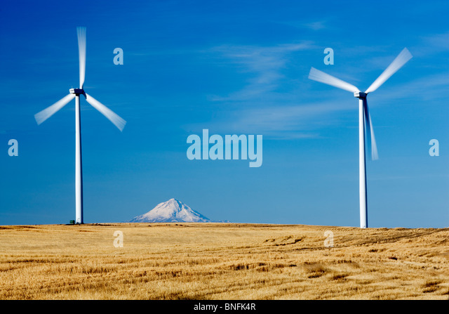 Wind turbins and Mt. Hood near Wasco, Oregon - Stock Image