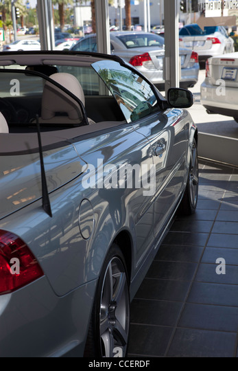 Luxury car stationary at showroom - Stock Image