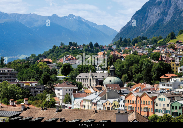 Austria, Tyrol, Innsbruck, View of city with mountains in background - Stock Image