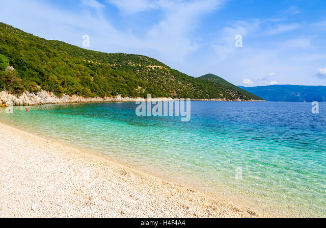 Beautiful crystal clear water of Antisamos beach on Kefalonia island, Greece - Stock Image