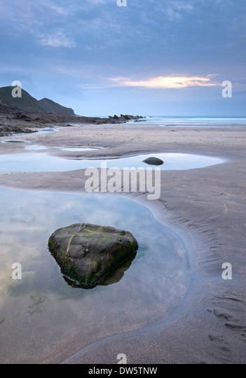 Rock pools on the beach at Crackington Haven during twilight, Cornwall, England. Summer (July) 2013. - Stock Image