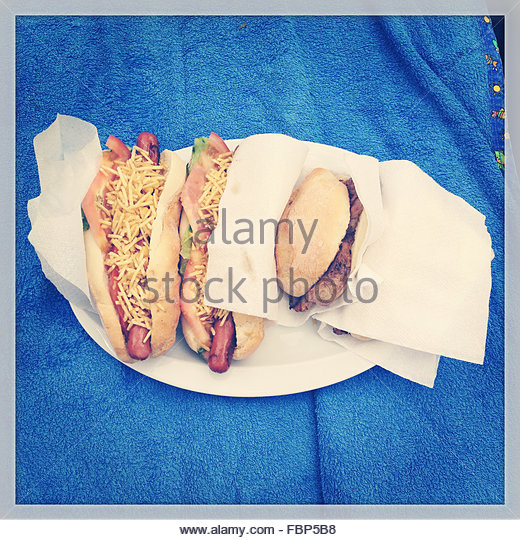 Elevated View Of Hamburger And Two Hot Dogs - Stock-Bilder