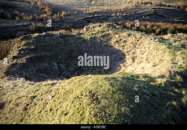 Industrial Archaeology indentation in the ground maybe to hold a boiler (continued) - Stock Image