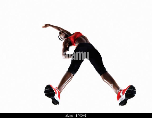 Female Athlete Stretching - Stock Image