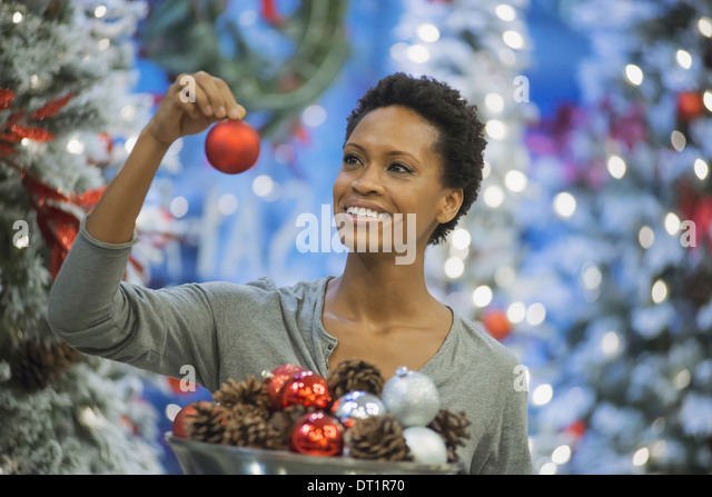 Woman at home decorating for Holidays - Stock Image