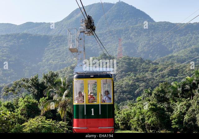 Tourists in Teleforico cable car gondola above rainforest on Pico Isabel de Torres mountain Puerto Plata Dominican - Stock Image