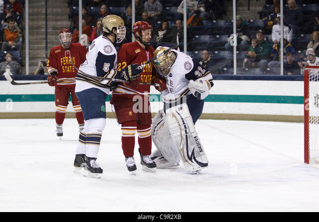 Feb. 10, 2012 - South Bend, Indiana, U.S - Notre Dame defenseman Robbie Russo (#5) protects his goaltender Mike - Stock Image