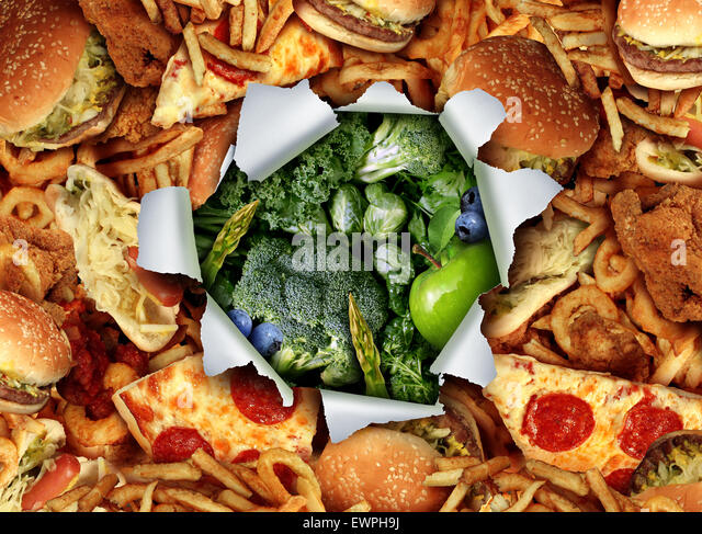 Diet lifestyle change concept and breaking out and escape from unhealthy habits of eating fatty junk food towards - Stock Image